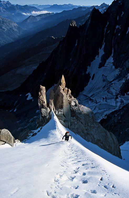 mountain climber trekking through the snow