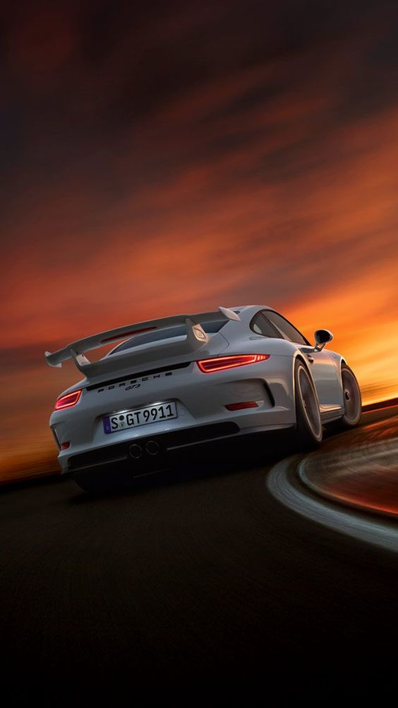 white porsche sunset
