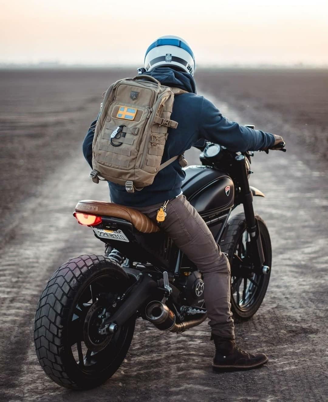 man on motorcycle scramblin