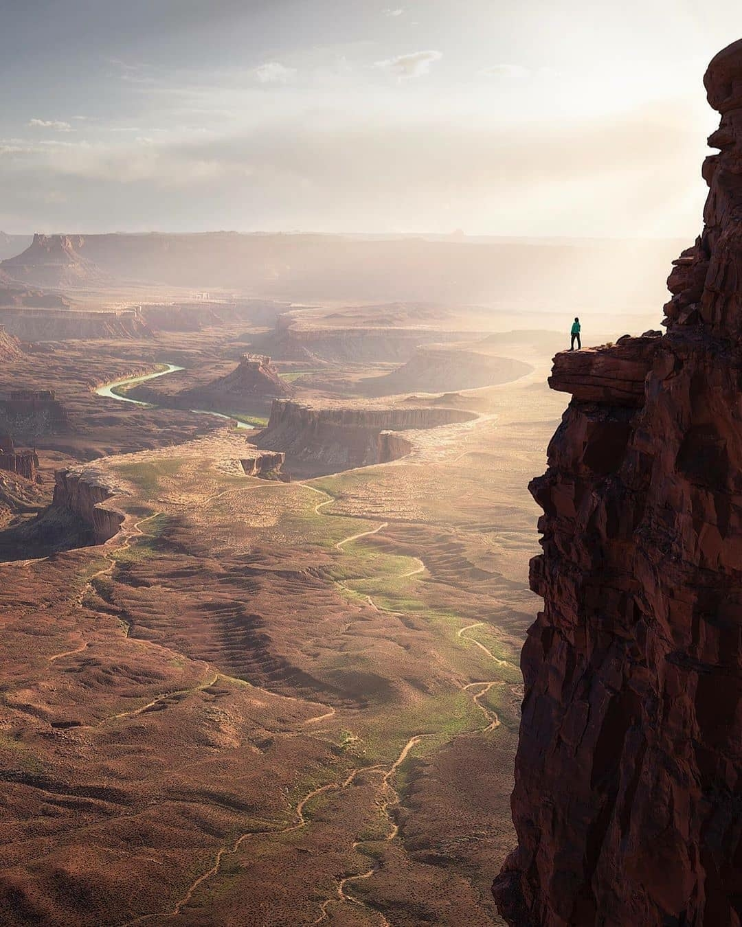 man standing on cliff in Utah