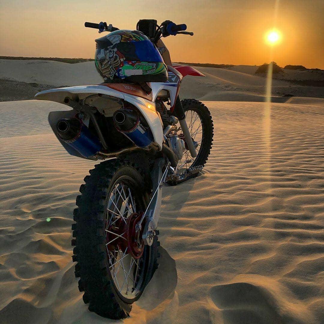 motorcycle sand sunset