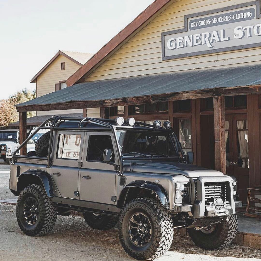defender in front of general store