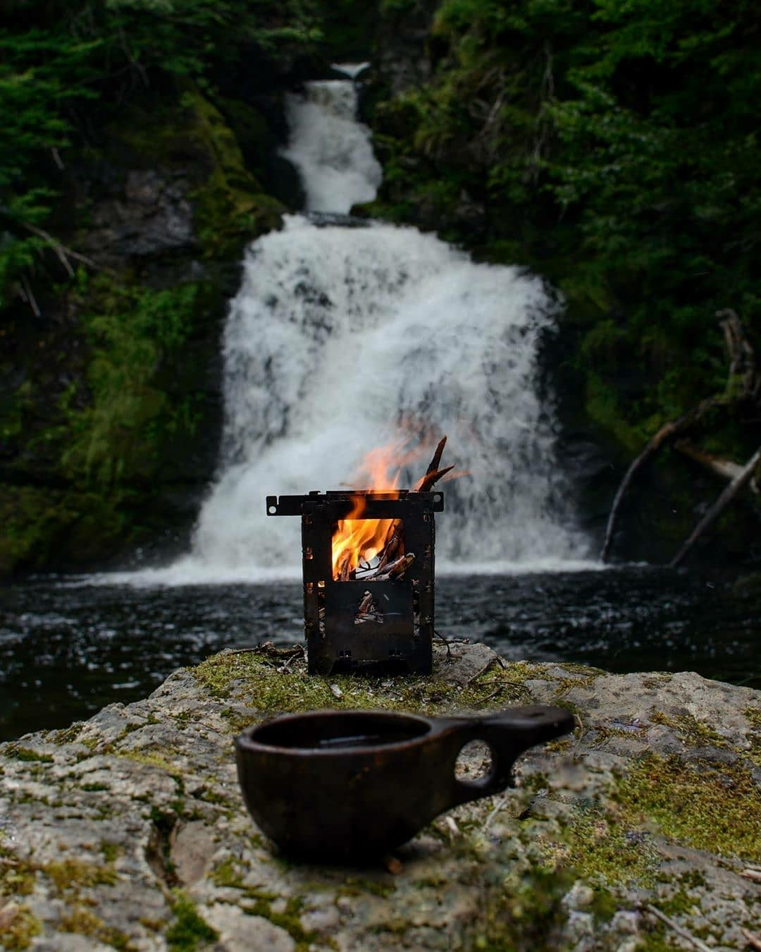 camping in front of waterfall
