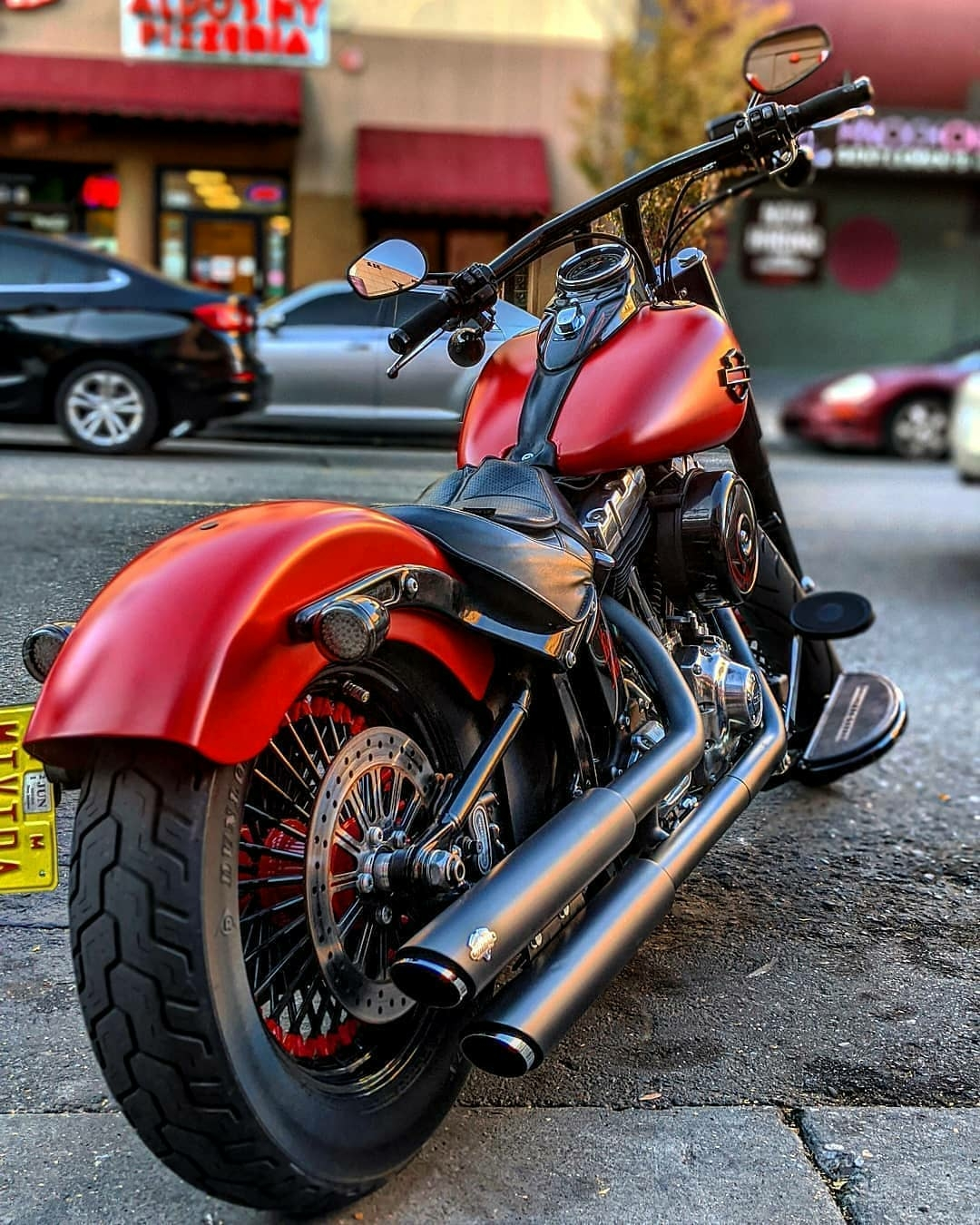 red harley parked on street