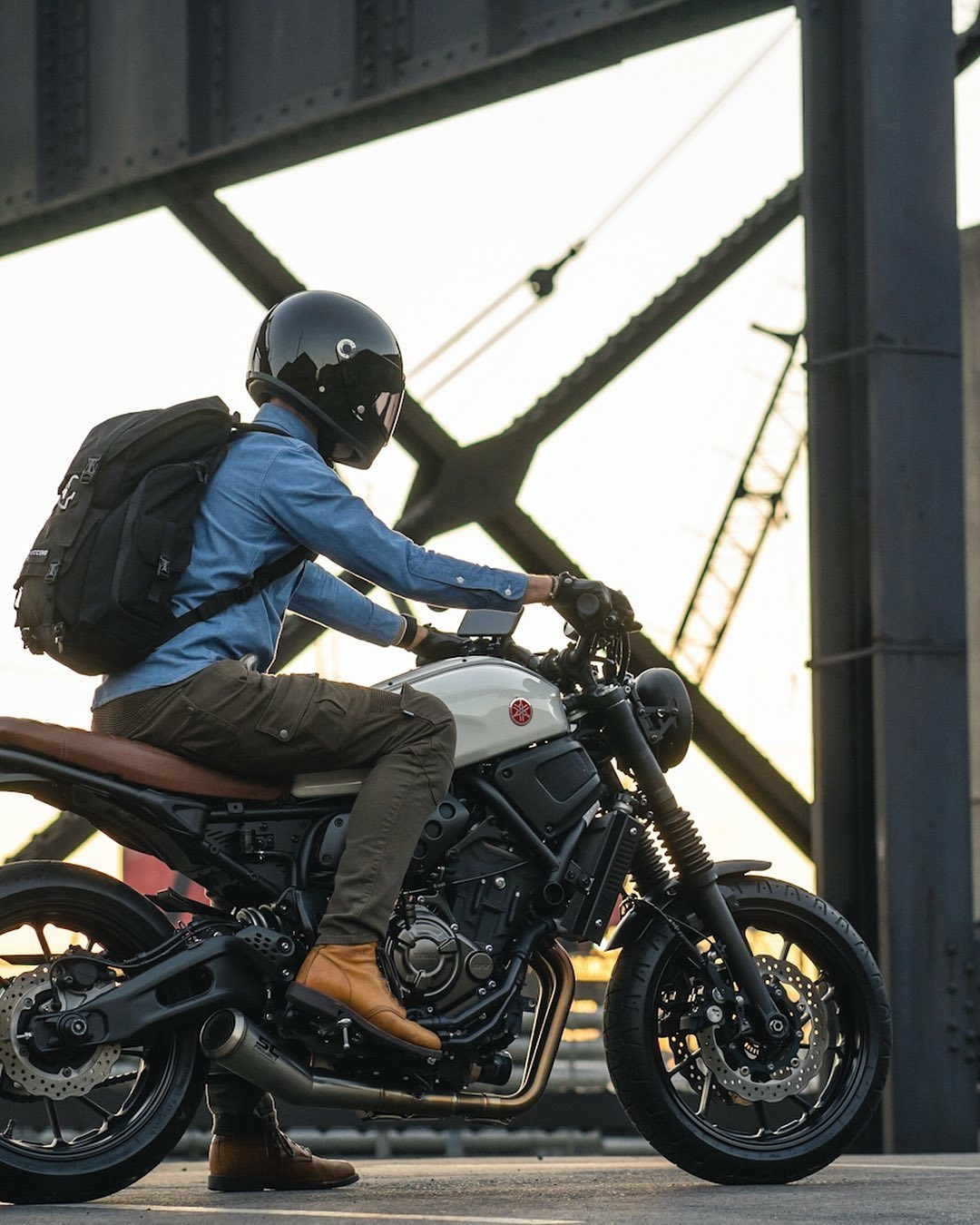 man riding yamaha motorcycle