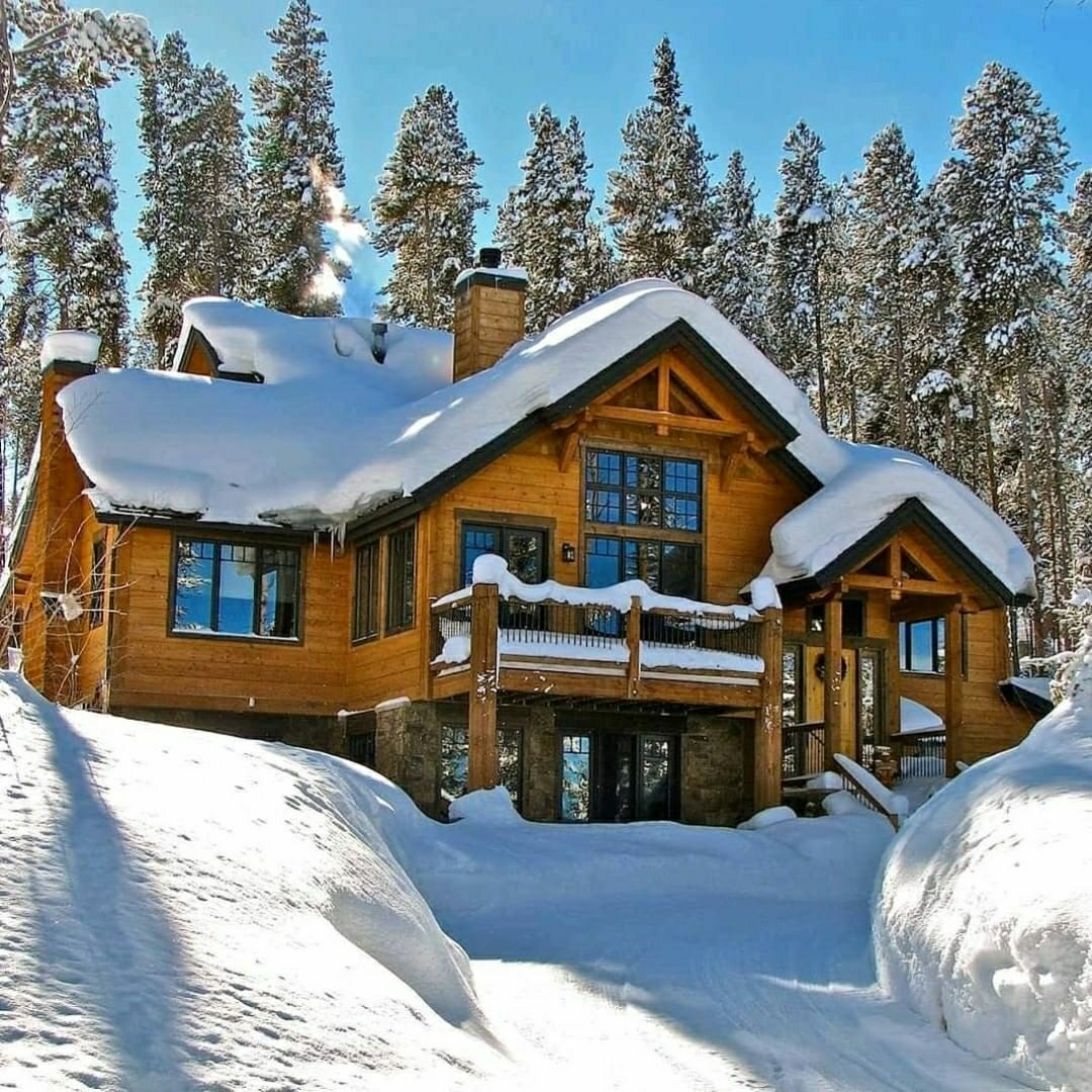 large snowy cabin in the mountains