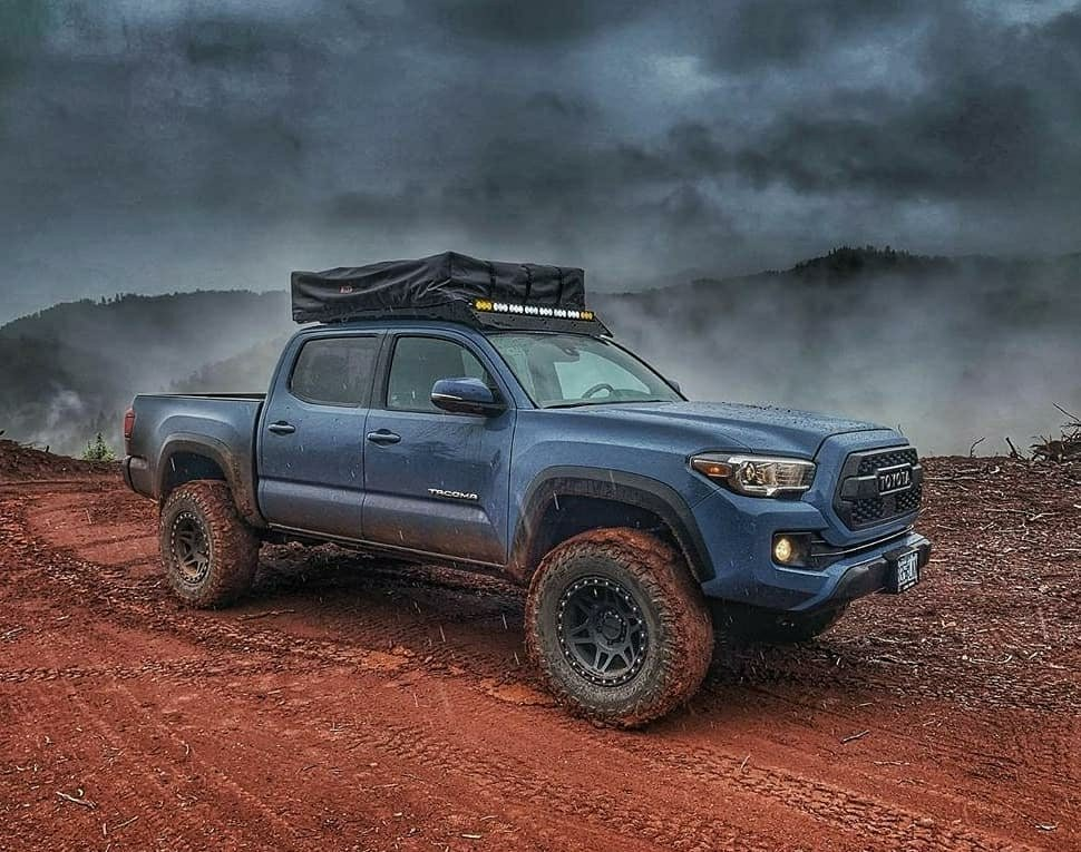 toyota tacoma with ominous sky above