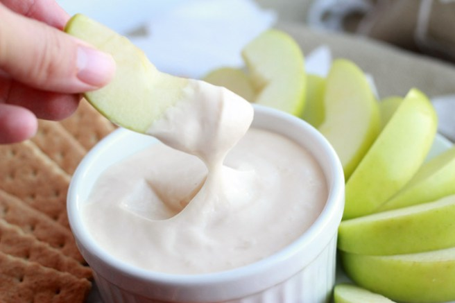 This three-ingredient caramel cream cheese yogurt dip makes a perfect afternoon snack or holiday party treat to share.