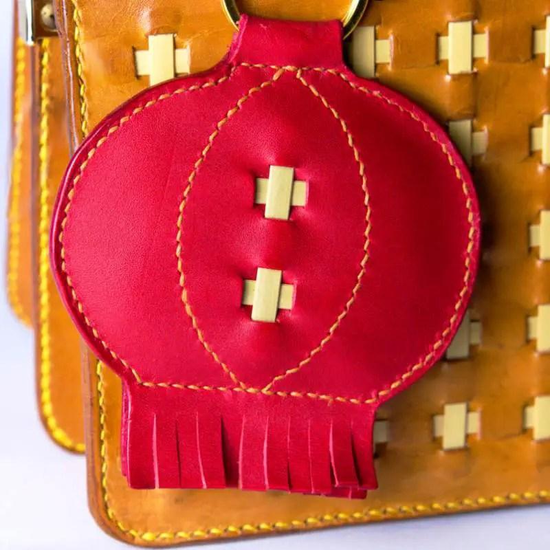 lantern bag charm and brown purse