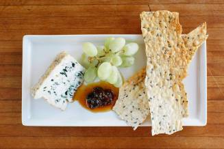 cheese plate w caramelized peach jam & house made lavosh
