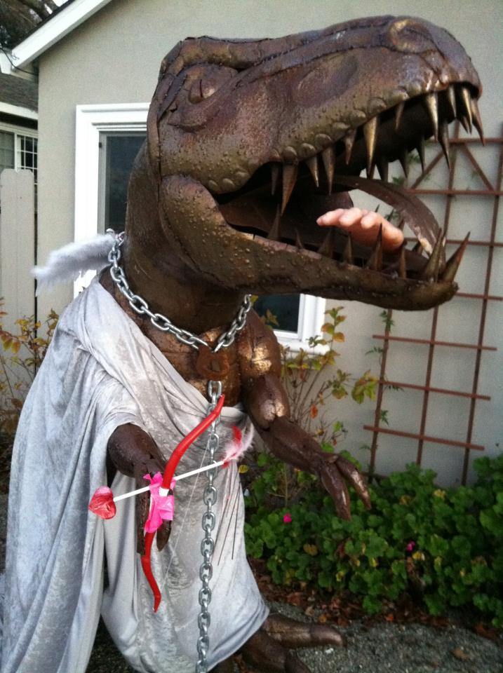These Folks Have A Lawn Dinosaur And They Dress Him Up In