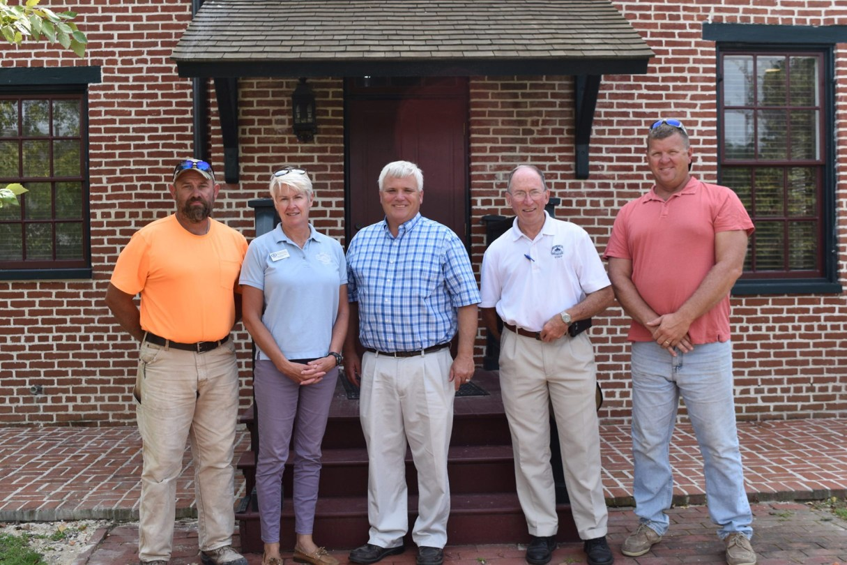 With Chesapeake Bay Maritime Museum President Kristen Greenaway and Vice President of Facilities Management Bill Gilmore are Tom Conneely, Dave Smith, and Brian Barnes of D.W. Masonry.