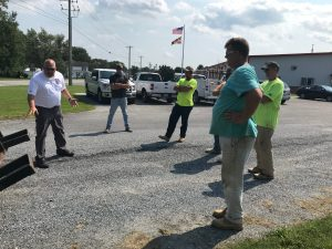 Troy Smith of DOT Compliance Consultants, LLC speaking with one of D.W. Masonry, Inc.'s Teams