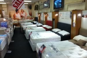 Beds on display in a store...