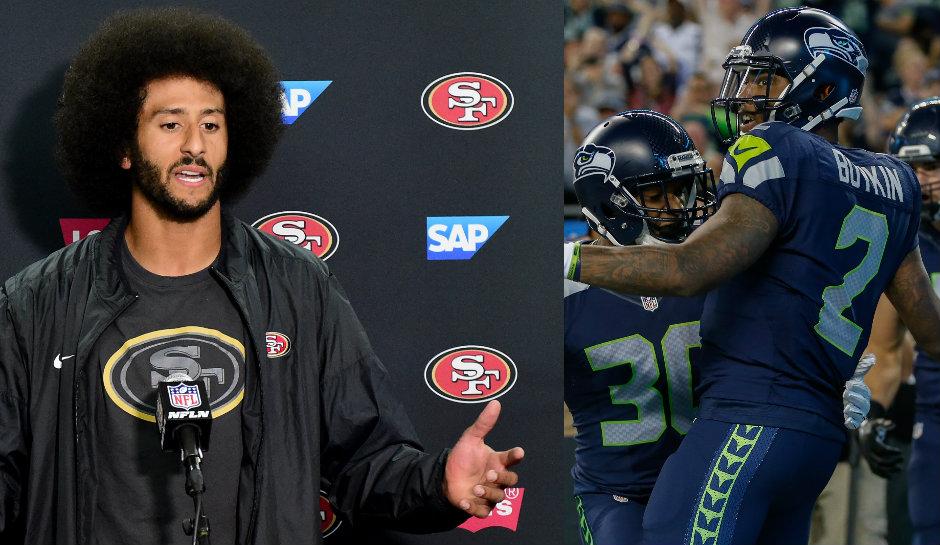Two Quarterbacks Colin Kaepernick SF 49ers and Jeremy Lane Seattle Seahawks Sit During National Anthem