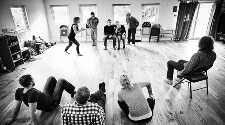 A group of people taking an Improv class with The Maydays