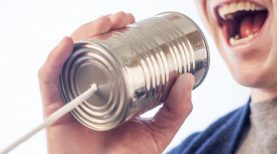 somebody's mouth speaking into a tin can phone