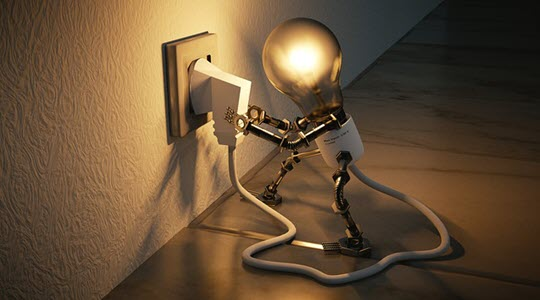 a light bulb with legs plugging itself in