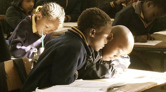 children at a school desk working