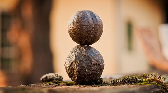 Two round stones balanced on top of each other