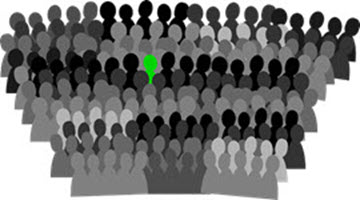 Large group of sillhouetted people with one person coloured green