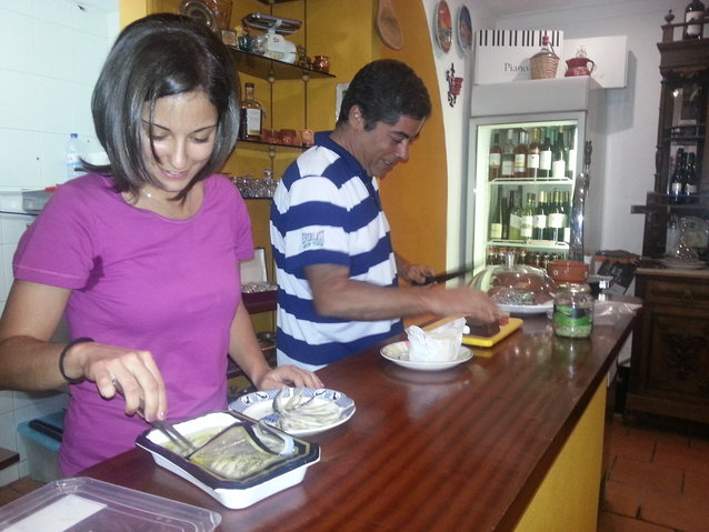 Catarina and Paulo serving up some other hungry diners. She's plating biquierao; he's slicing muchama