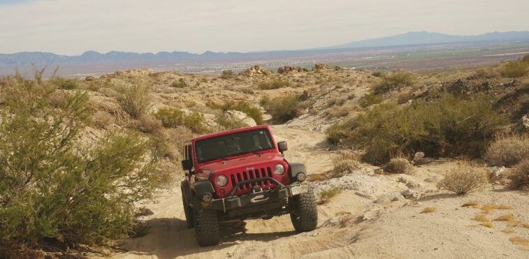 Jeep driving off-road in a US desert trail