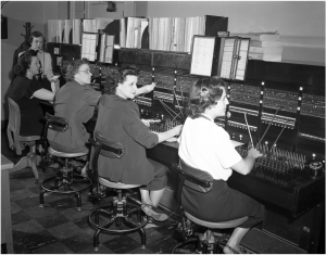 Telephone Switchboard with Operators, photograph, January 15, 1950; (texashistory.unt.edu/ark:/67531/metapth40667/m1/1/: accessed October 20, 2016), University of North Texas Libraries, The Portal to Texas History, texashistory.unt.edu; crediting Lockheed Martin Aeronautics Company, Fort Worth TX.