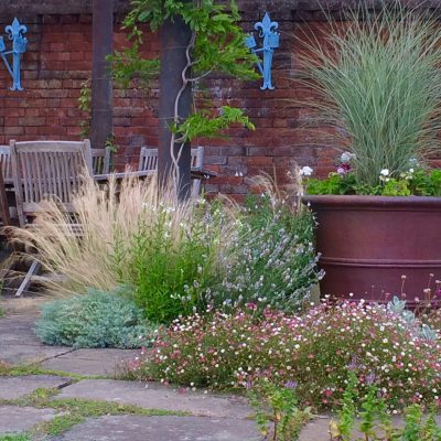 Grasses in copper pot at Doddington Place Gardens