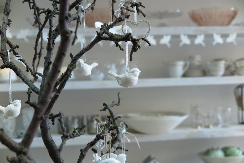 A garden branch as a Christmas table centrepiece