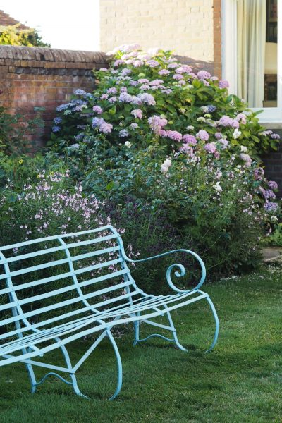 Think about planting and garden furniture together.