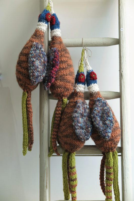 Hand-knitted pheasants