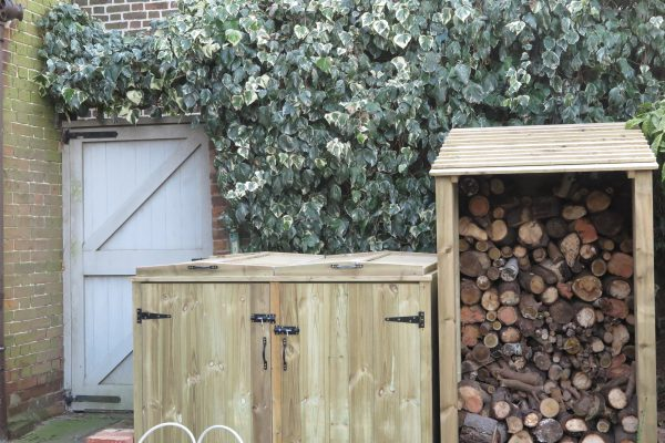 Our gate, log store and bin store before painting