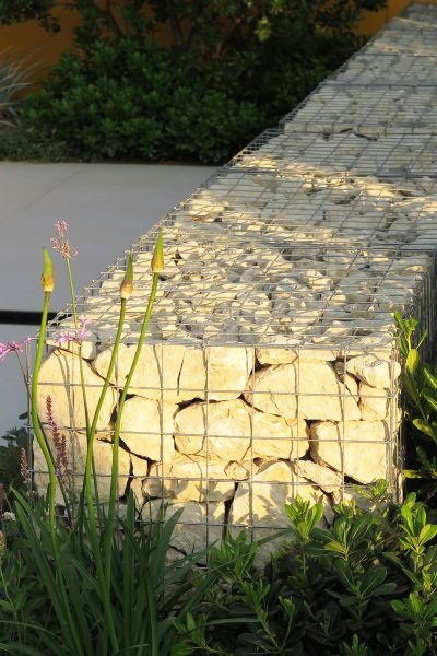 Rocky retainer wall as bench
