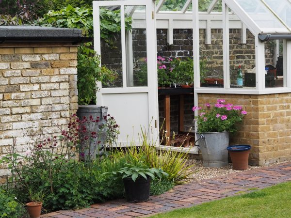 Use a limited palette of hard landscaping materials when starting a garden from scratch