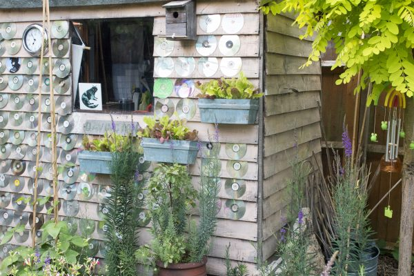 Use CDs to reflect light off your shed