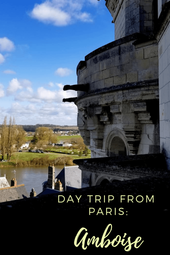 image of the outside of Chateau Royal d'Amboise with gargoyles over the Loire river. Text reads: Day trip from Paris: Amboise'