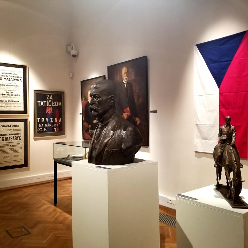 Czech flag in the background and a few statues in the foreground at the Eastern Slovak Museum. There is a bust of a former (unknown) general.