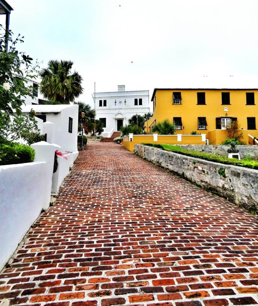 Looking up an old brick street with colonial buildings in St. George's, Bermuda