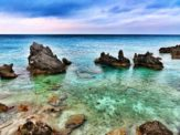 Clear turquoise water and limestone rock formations at Tobacco Bay, Bermuda