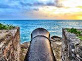 Shot of the sunrise from seated atop a cannon overlooking the ocean at Gates Fort in St. George's, Bermuda