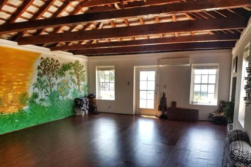Interior studio space of Just Breathe Yoga in St. George's, Bermuda