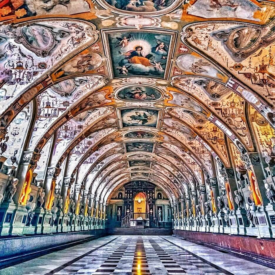 Interior of the Residenz in Munich, Germany - bright colors and sharp lines looking down the main hall