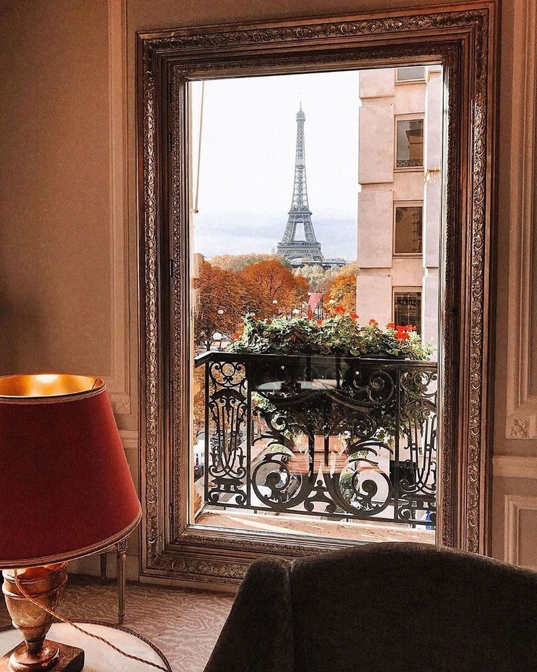 View out a hotel room window at the Plaza Athenee in Paris, the Eiffel Tower in the background