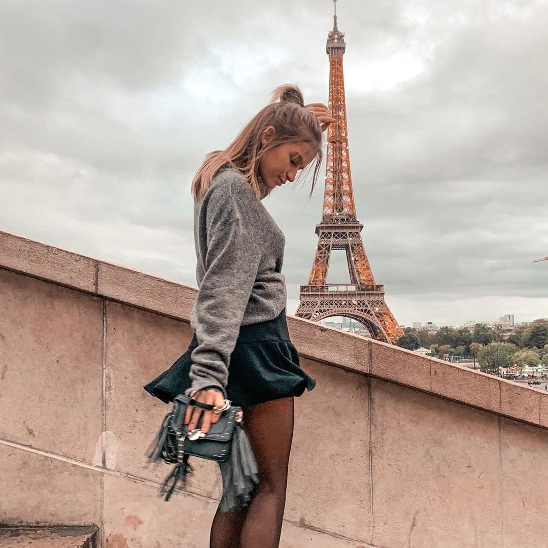 Woman standing on steps in front of Eiffel Tower at Trocadero