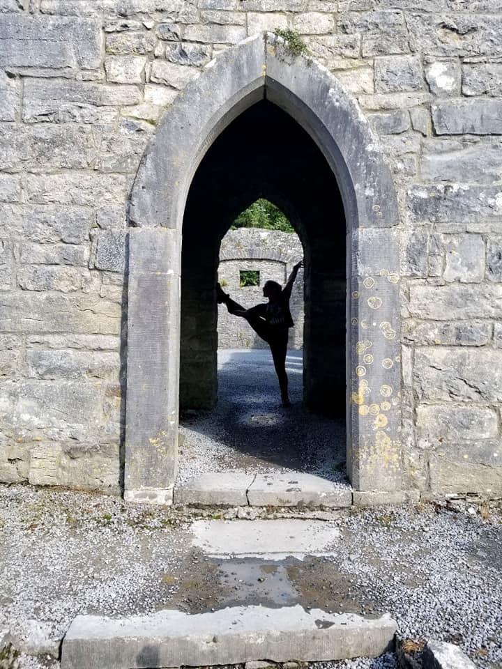 Woman doing yoga in doorway in Ireland