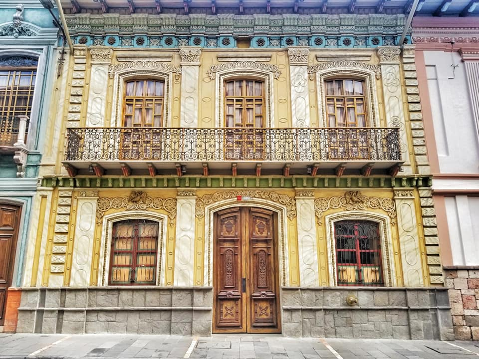 Colorful facade of colonial building in Cuenca, Ecuador, one of the best destinations for digital nomads in South America.