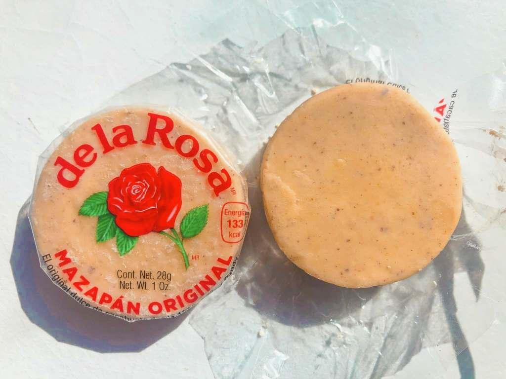 Circular piece of de la Rosa Mazapan, an original Mexican candy.