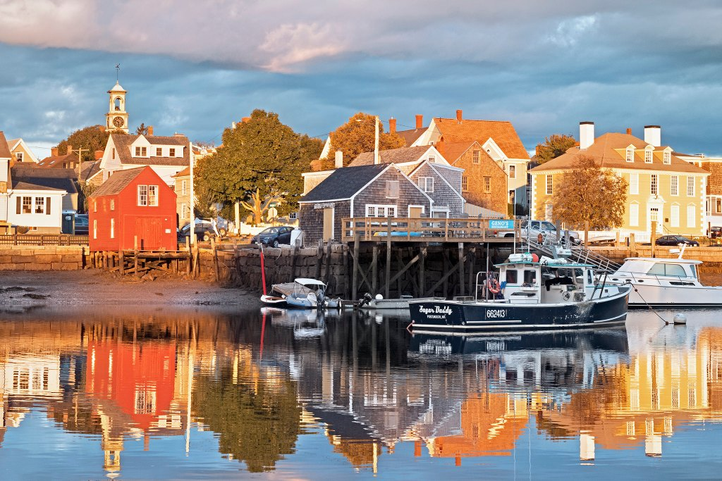 Buildings in Portsmouth, NH reflected on the waterfront - an easy day trip from Boston.