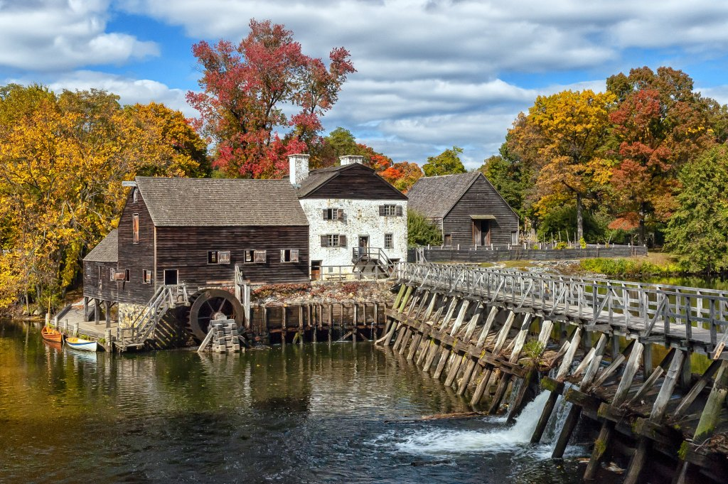 Old mill in Sleepy Hollow, New York with autumn colored leaves.